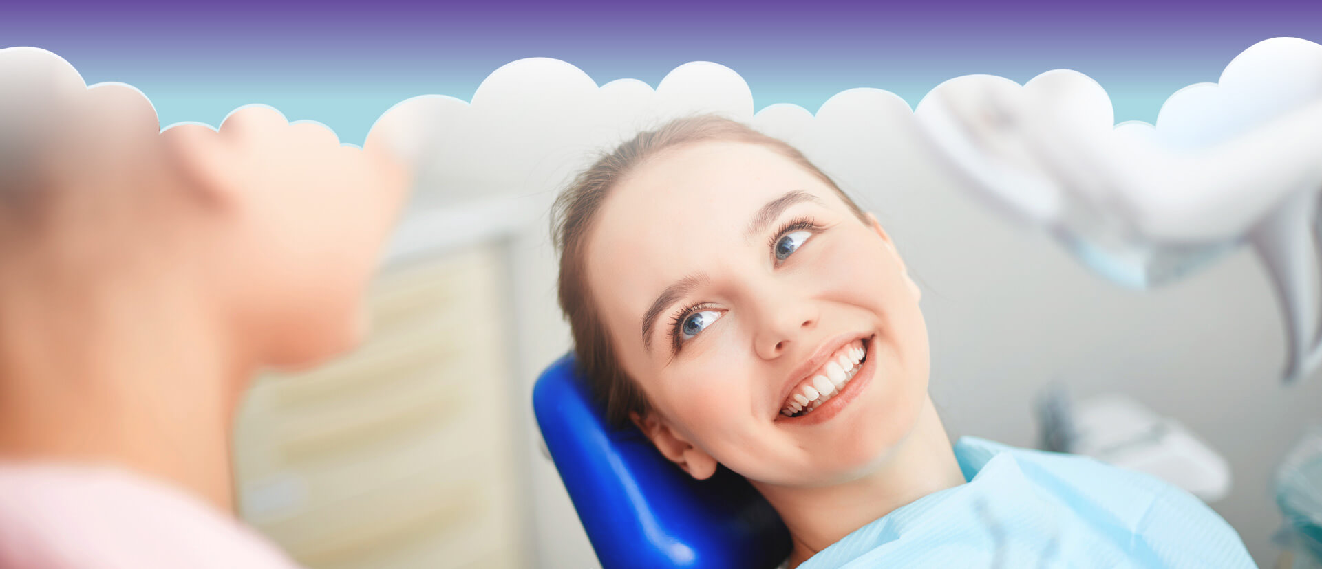 Happy female patient smiling at dentist