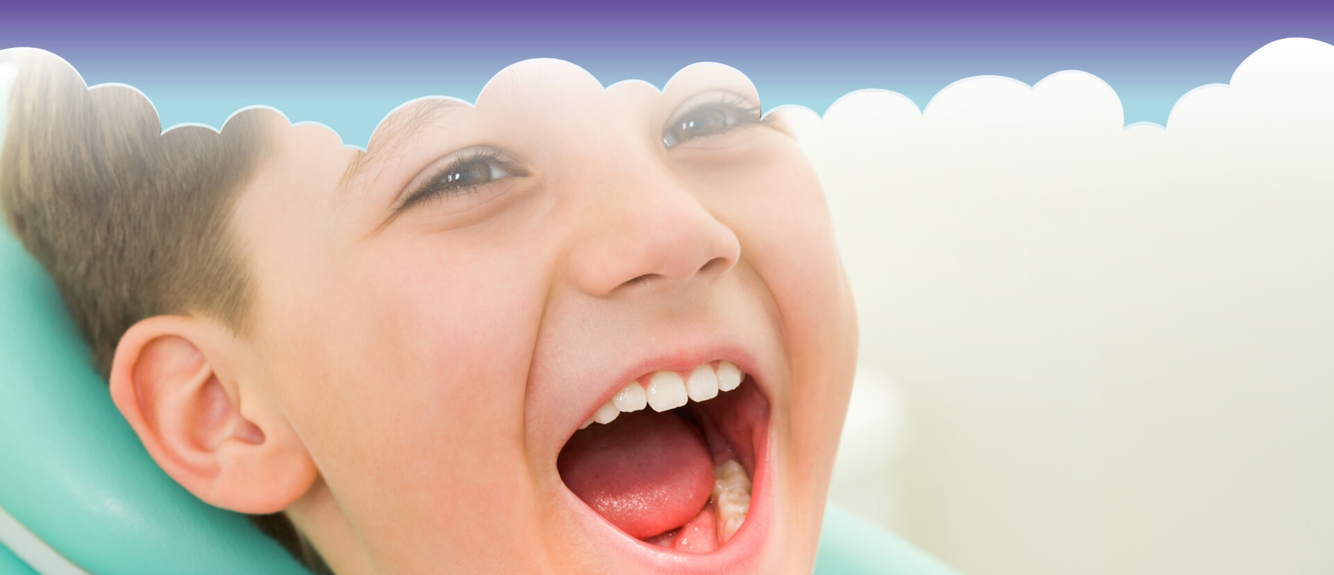 Young child smiling with his mouth wide open